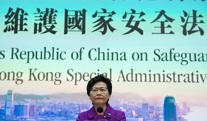 Chief Executive Carrie Lam speaks to the press about the national security law in July. Photo: Robert Ng