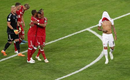 Soccer Football - World Cup - Group C - Peru vs Denmark - Mordovia Arena, Saransk, Russia - June 16, 2018 Denmark's players celebrate after the match as Peru's Paolo Guerrero looks dejected REUTERS/Ricardo Moraes