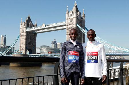 Athletics - London Marathon - Elite Men Press Conference - London, Britain - April 19, 2018 Kenya's Daniel Wanjiru and Eliud Kipchoge pose for a photograph Action Images via Reuters/Peter Cziborra