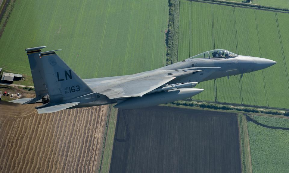 An F-15C Eagle flies over East Anglia, England, Aug. 27, 2015, during a flyover event at Royal Air Force Lakenheath. The F-15C, assigned to the 48th Fighter Wing, circulated until it flew in unison with the U.K. Avro Vulcan XH558 to mark the first and last time these aircraft will fly together. (Photo by Senior Airman Trevor T. McBride/U.S. Air Force) *** Please Use Credit from Credit Field ***