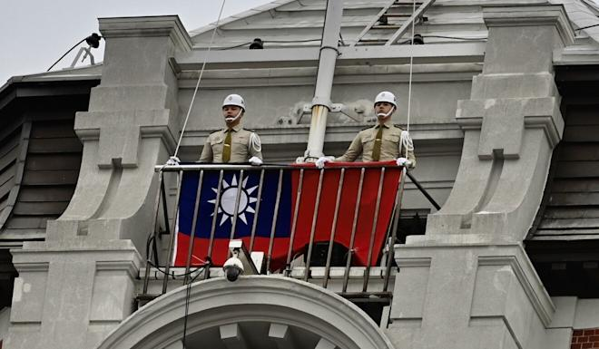 Taiwan's military police prepare to raise the flag. Photo: AFP