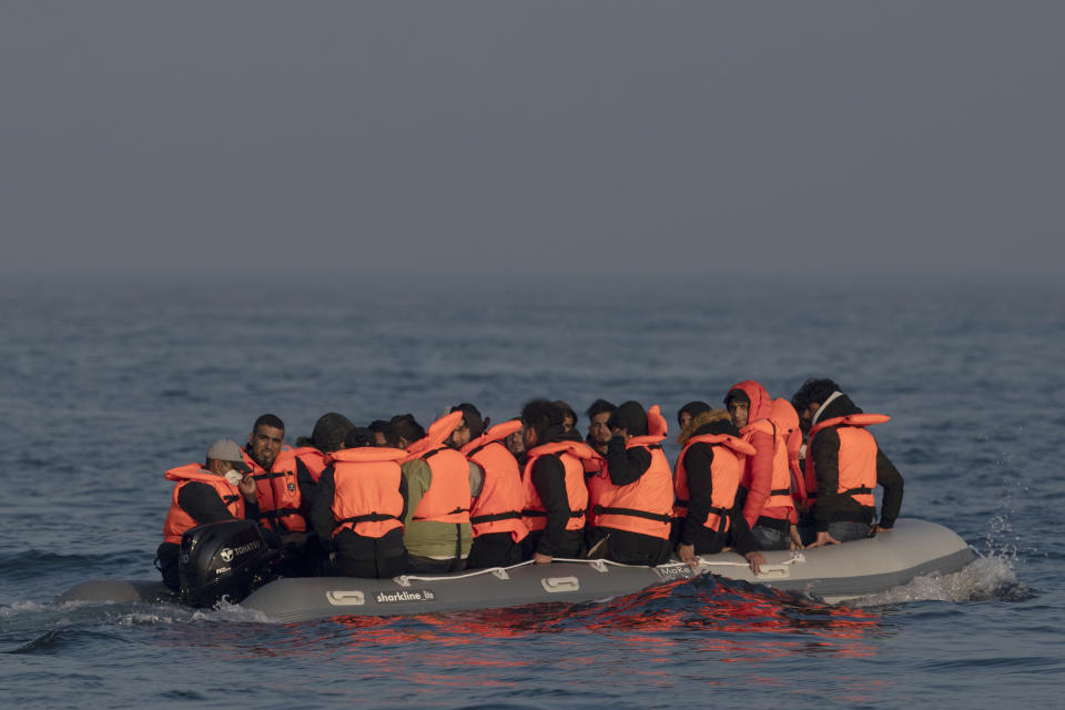 AT SEA, ENGLAND - JULY 22: An inflatable craft carrying migrant men, women and children crosses the shipping lane in the English Channel on July 22, 2021 off the coast of Dover, England. On Monday, 430 migrants crossed the channel from France, a record for a single day. To stem the rising numbers, the British and French governments announced yesterday a deal under which the UK will pay over £54 million and France will double the number of police patrolling the beaches from which migrants launch their boats. (Photo by Dan Kitwood/Getty Images)