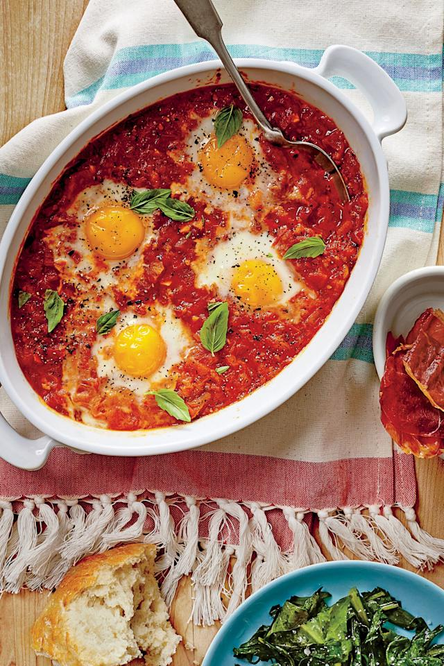 """<p><b>Recipe: <a href=""""https://www.southernliving.com/recipes/stewed-tomato-shirred-eggs-ham-chips-recipe"""">Stewed Tomato Shirred Eggs with Ham Chips</a></b></p> <p>As the tomato sauce bubbles, the eggs poach in the stew to make this morning-to-night dish ready in a snap.</p>"""