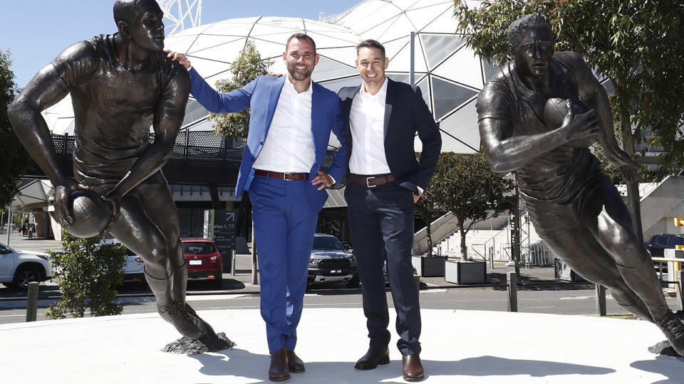 Cameron Smith and Billy Slater, pictured here posing for a photo with their statues outside AAMI Park.