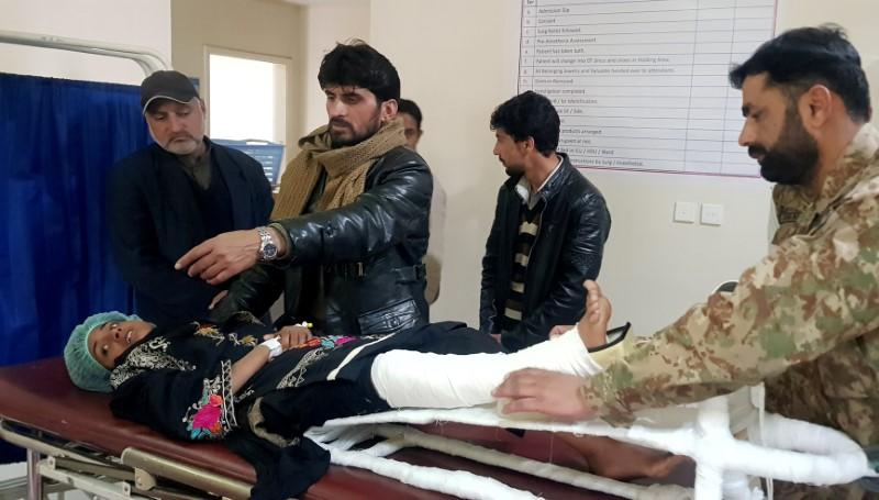 Samina, who was rescued after a heavy snowfall and avalanches in Bakwali village in Neelum Valley, receives first aid at a hospital in Muzaffarabad,