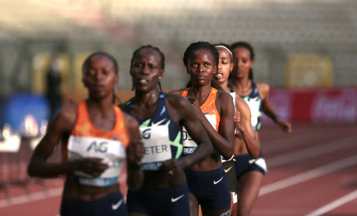 Kenya's Brigid Kosgei, center, during the One Hour Women at the Diamond League Memorial Van Damme athletics event at the King Baudouin stadium in Brussels on Friday, Sept. 4, 2020. (AP Photo/Virginia Mayo)
