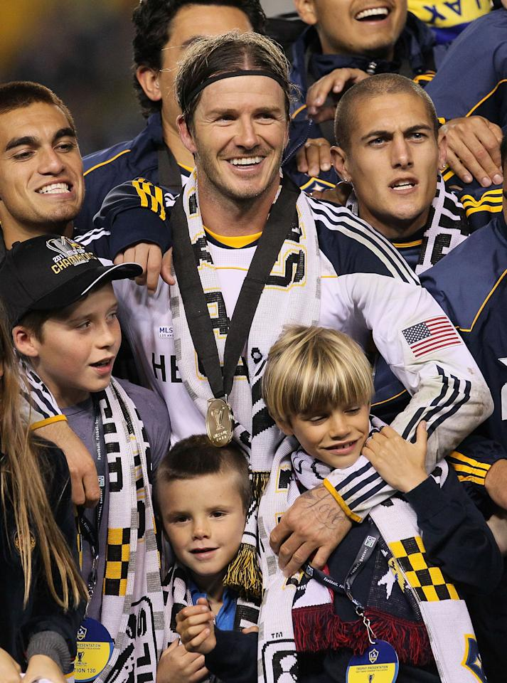 CARSON, CA - NOVEMBER 20:  David Beckham #23 of the Los Angeles Galaxy celebrates with his sons Brooklyn, Cruz and Romeo after defeating the Houston Dynamo 1-0 to win the 2011 MLS Cup at The Home Depot Center on November 20, 2011 in Carson, California.  (Photo by Stephen Dunn/Getty Images)