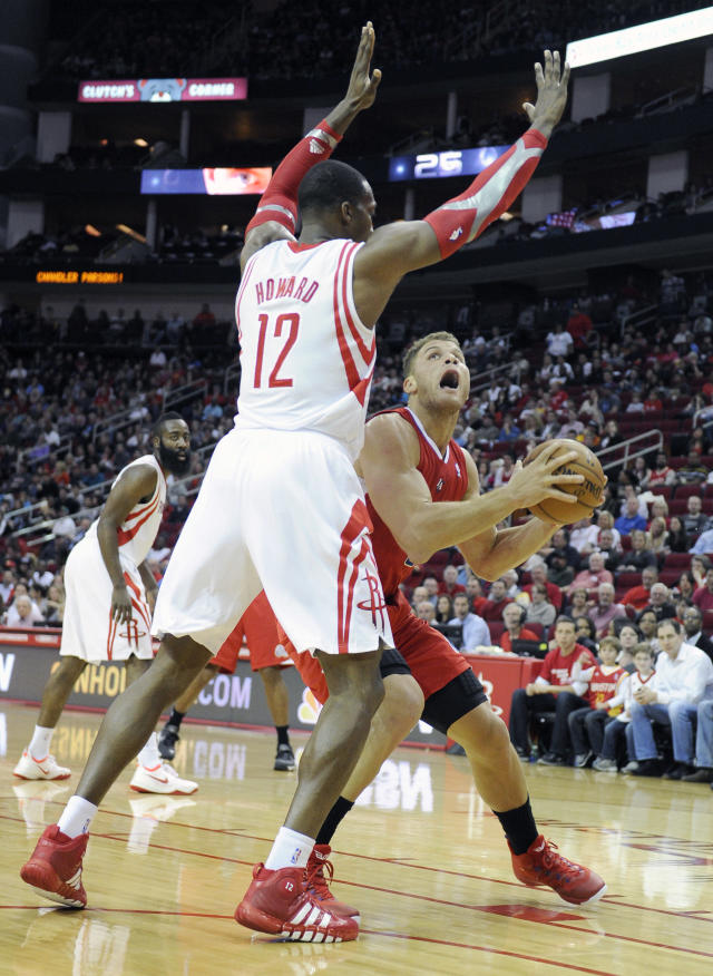 Houston Rockets' Dwight Howard (12) hovers over Los Angeles Clippers' Blake Griffin in the first half of an NBA basketball game on Saturday, Nov. 9, 2013, in Houston. (AP Photo/Pat Sullivan)
