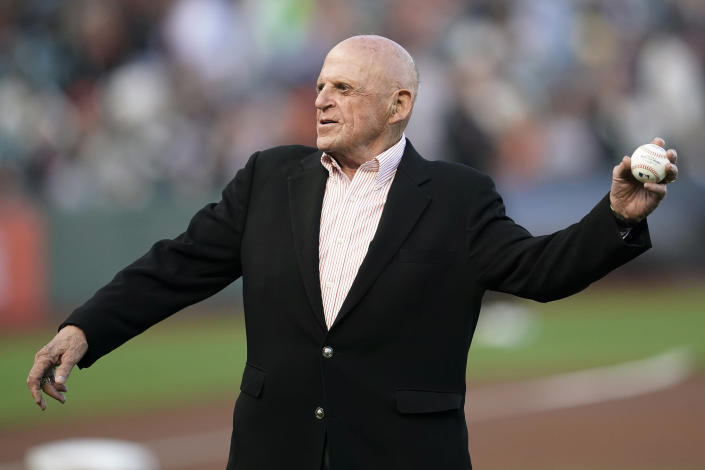 Former San Francisco Giants owner Bob Lurie throws out the ceremonial first pitch before a baseball game between the Giants and the Atlanta Braves in San Francisco, Saturday, Sept. 18, 2021. (AP Photo/Jeff Chiu)
