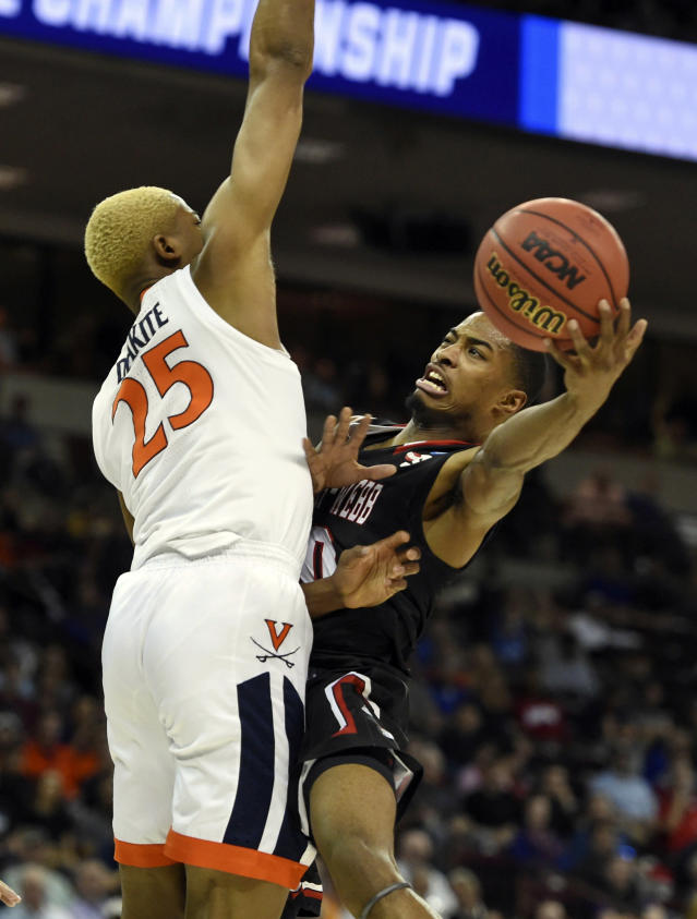 Gardner-Webb's Nate Johnson, right, shoots around Virginia's DJ Laster (25) during a first-round game in the NCAA mens college basketball tournament in Columbia, S.C., Friday, March 22, 2019. (AP Photo/Richard Shiro)