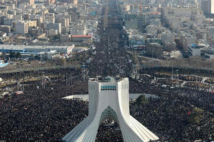 Iranian mourners filled the streets of Tehran on Monday to pay tribute to Soleimani who headed the foreign operations of Iran's elite Revolutionary Guards (AFP Photo/-)