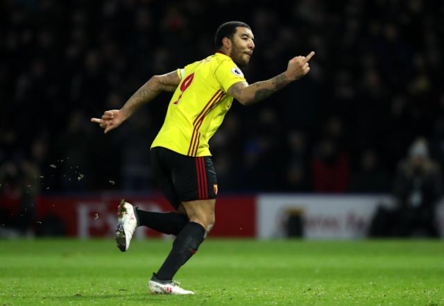 Troy Deeney gives the middle finger to Chelsea fans after his goal from the penalty spot. (Getty)
