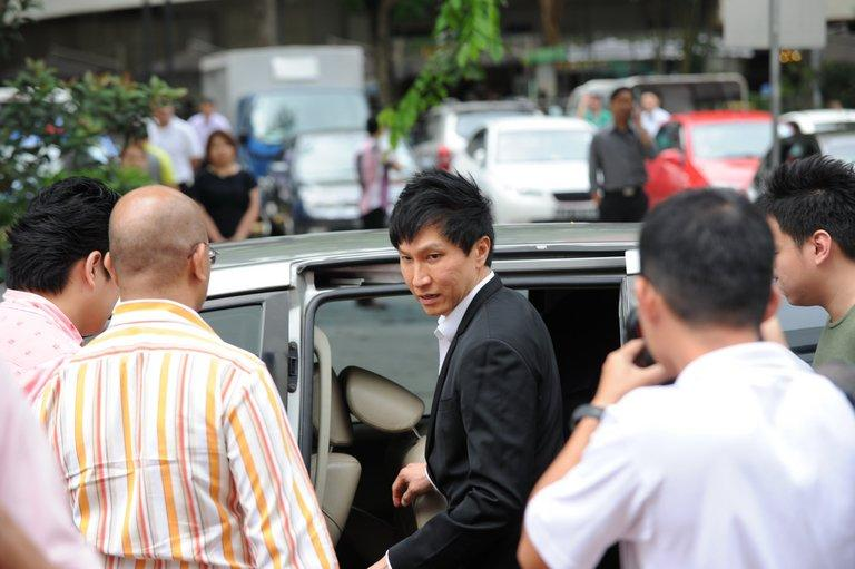 City Harvest Church founder Kong Hee (C) leaves the Subordinate courts in Singapore on May 16, 2013