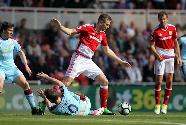 <p>Middlesbrough's Ben Gibson and Burnley's Ashley Barnes (floor) battle for the ball</p>