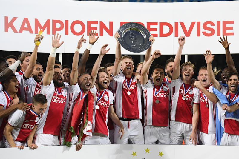 Ajax captain Matthijs de Ligt holds the champions plate aloft. (Credit: Getty Images)