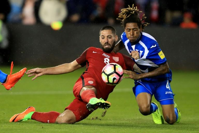 Clint Dempsey of the United States scores one of his three goals in a 6-0 thrashing of Honduras during their FIFA 2018 World Cup Qualifier