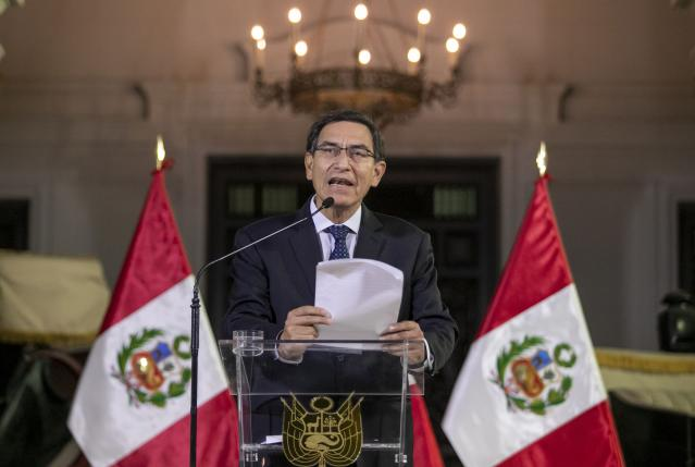 In this photo provided by the Peruvian presidential press office, Peru's President Martin Vizcarra delivers a national message from the government palace in Lima, Peru, Monday, Sept. 30, 2019. Vizcarra announced he had dissolved his nation's opposition-controlled congress amid a bitter feud over his fight to curb corruption. (Andres Valle/Peruvian presidential press office, via AP)