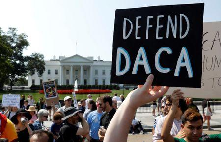 FILE PHOTO: Demonstrators protest in front of the White House after the Trump administration today scrapped the Deferred Action for Childhood Arrivals (DACA), a program that protects from deportation almost 800,000 young men and women who were brought into the U.S. illegally as children, in Washington, U.S., September 5, 2017. REUTERS/Kevin Lamarque