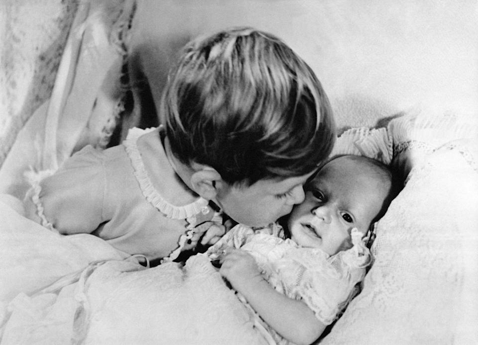 """<p>Prince Charles, 2, gives his newborn sister, Princess Anne, a kiss on the cheek. Prince George and Princess Charlotte were photographed in <a href=""""https://www.harpersbazaar.com/celebrity/latest/a20197532/prince-louis-first-official-photo-compared-to-princess-charlotte/"""" rel=""""nofollow noopener"""" target=""""_blank"""" data-ylk=""""slk:similar poses"""" class=""""link rapid-noclick-resp"""">similar poses</a> for their first photos with their siblings. </p>"""