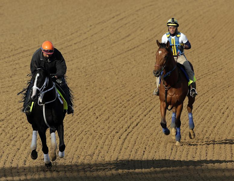 Exercise rider Aurelio Gomez rides Kentucky Derby hopeful Black Onyx, left, and Trainer Rudy Rodriguez rides Vyjack for a workout at Churchill Downs Tuesday, April 30, 2013, in Louisville, Ky. (AP Photo/Charlie Riedel)