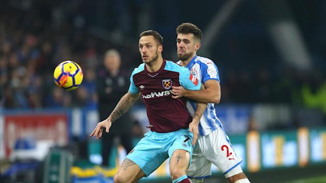 West Ham extended their unbeaten league run to four games with a 4-1 victory over Huddersfield Town, a win inspired by Marko Arnautovic.