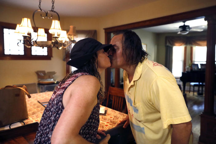Dan O'Conor and his wife Margaret O'Conor shares a kiss before heading out for his 365th plunge into Lake Michigan, Saturday, June 12, 2021, at his home in Chicago's Lincoln Park. (AP Photo/Shafkat Anowar)