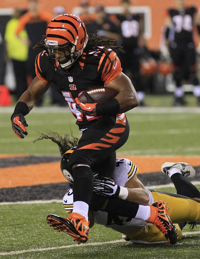 Cincinnati Bengals running back BenJarvus Green-Ellis (42) is tackled by Pittsburgh Steelers strong safety Troy Polamalu in the first half of an NFL football game, Monday, Sept. 16, 2013, in Cincinnati. (AP Photo/Tom Uhlman)