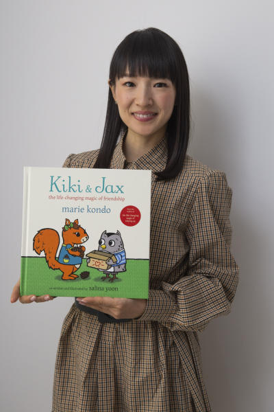 """Author and television personality Marie Kondo poses for a portrait to promote her children's book """"Kiki & Jax: The Life-Changing Magic of Friendship"""" on Monday, Nov. 4, 2019, in New York. (Photo by Andy Kropa/Invision/AP)"""