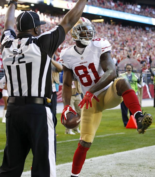 San Francisco 49ers wide receiver Anquan Boldin (81) celebrates his touchdown as side judge Michael Banks (72) makes the call during the first half of an NFL football game against the Arizona Cardinals, Sunday, Dec. 29, 2013, in Glendale, Ariz. (AP Photo/Ross D. Franklin)