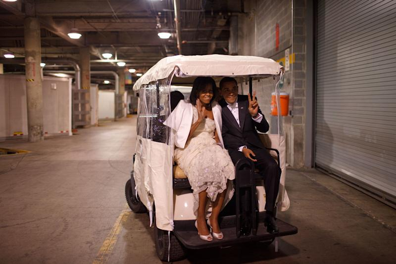 President Barack Obama and first lady Michelle Obama ride on a golf cart at an inaugural ball on Jan. 20, 2009.
