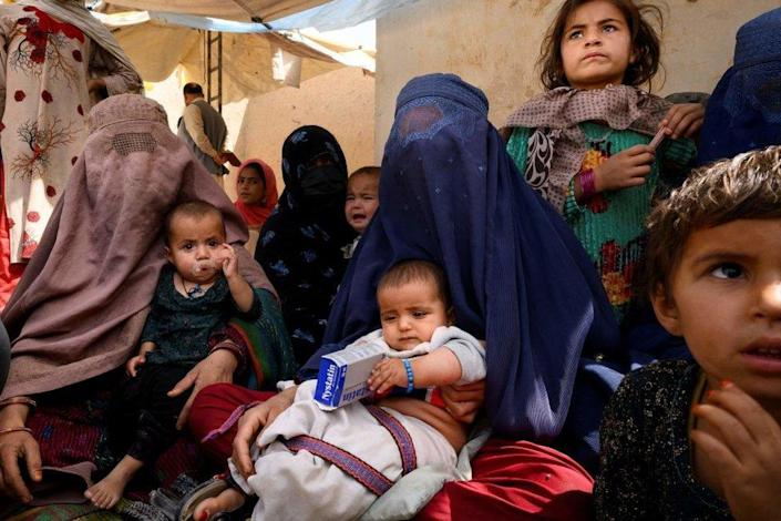 Women wait for their turn at a mobile clinic for women and children set up at the residence of a local elder in Yarmuhamad village, near Lashkar Gah in Helmand province.