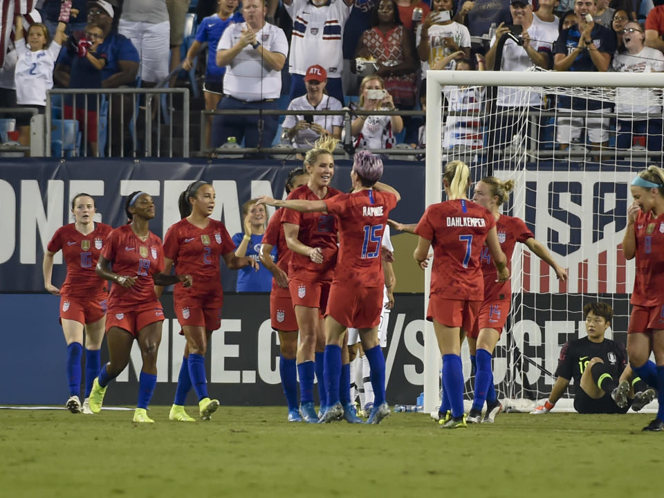 United States' Allie Long celebrates with Megan Rapinoe (15) after scoring against South Korea during the first half of a soccer match Thursday, Oct. 3, 2019, in Charlotte, N.C. (AP Photo/Mike McCarn)