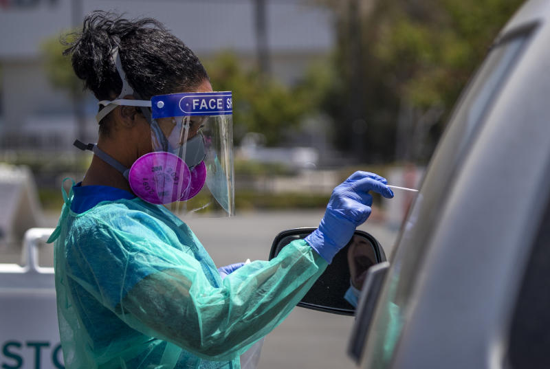 ANAHEIM, CA - JULY 09: Maritza Perez, a registered nurse, gives a COVID-19 test to one of a 50-to-65 patients per day at AltaMed Health Services in Anaheim on Thursday, July 9, 2020. (Allen J. Schaben / Los Angeles Times via Getty Images)