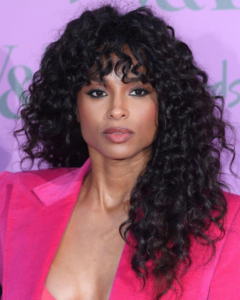 <p>Proving curly hair totally works with a fringe, Ciara's undone tousled bangs are so 2018.</p>