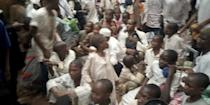Freed people are led away after police raided a house freeing men and boys in Kaduna
