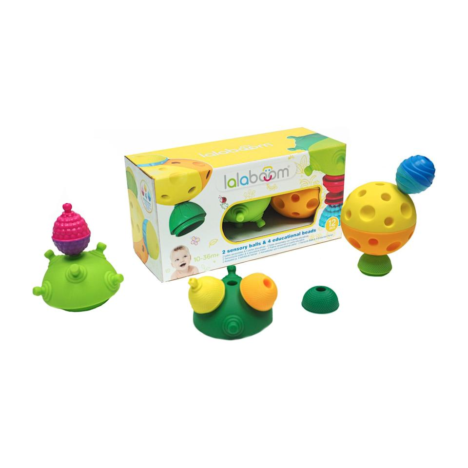 <p>Designed for toddlers ages 10-36 months, this <span>Lalaboom Sensory Balls and Beads Set</span> ($28) includes two sensory balls designed to help kids develop motor skills as well as an eight-piece snap bead set to enhance creativity.</p>