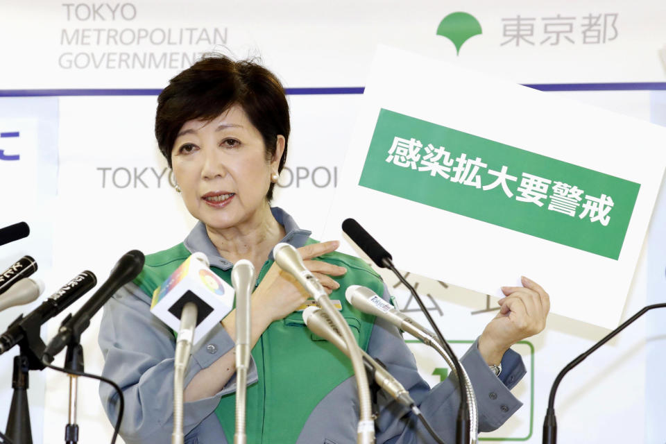 Tokyo Governor Yuriko Koike speaks during a press conference after a task force meeting against the new coronavirus at the Metropolitan Government Office Thursday, July 2, 2020, in Tokyo. The Japanese capital has confirmed more than 100 new cases of the coronavirus, the highest since early May, raising concern about a possible resurgence of the disease just as businesses return to normal. Gov. Koike, at a meeting with a panel of experts, said the infections are on the rise and extra caution is needed. Koike said many of the cases are linked to nightlife establishments, and urged workers to proactively take virus tests and further safety measures. (Kyodo News via AP)