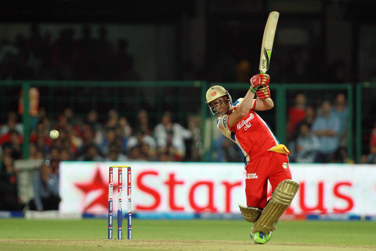 AB de Villiers hits the ball straight to a fielder to lose his wicket off the bowling of Shane Watson during match 27 of the Pepsi Indian Premier League between The Royal Challengers Bangalore and The Rajasthan Royals held at the M. Chinnaswamy Stadium, Bengaluru  on the 20th April 2013. (BCCI)