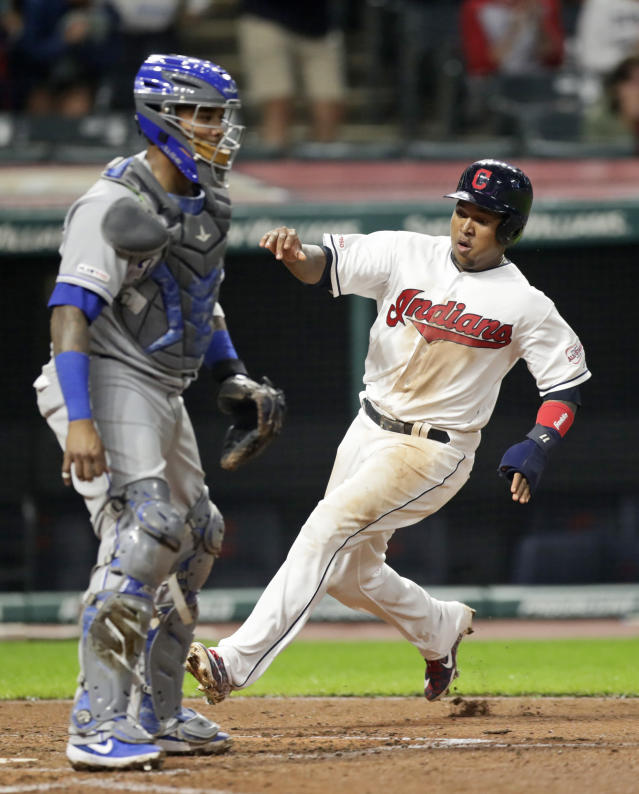 Cleveland Indians' Jose Ramirez, right, scores as Kansas City Royal catcher Martin Maldonado watches in the sixth inning in a baseball game, Monday, June 24, 2019, in Cleveland. (AP Photo/Tony Dejak)