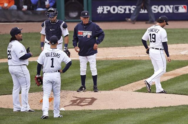 Detroit Tigers starting pitcher Anibal Sanchez (19) is pulled by manager Jim Leyland, center right, during the fifth inning of Game 3 of an American League baseball division series against the Oakland Athletics in Detroit, Monday, Oct. 7, 2013. (AP Photo/Charles Rex Arbogast)