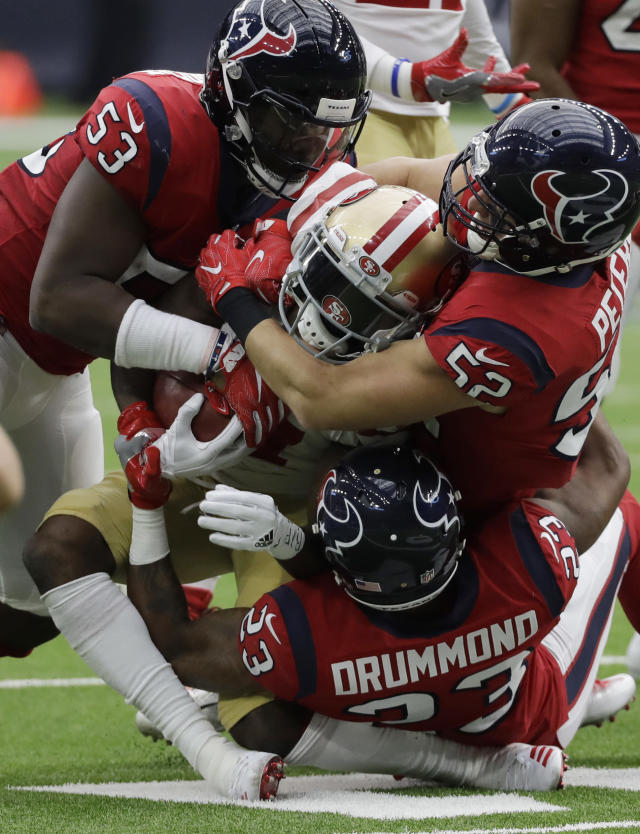 <p>San Francisco 49ers wide receiver Victor Bolden, center, is stopped by Houston Texans defenders Gimel President (53), Brian Peters (52) and Kurtis Drummond (23) during the first half of an NFL football game, Sunday, Dec. 10, 2017, in Houston. (AP Photo/David J. Phillip) </p>
