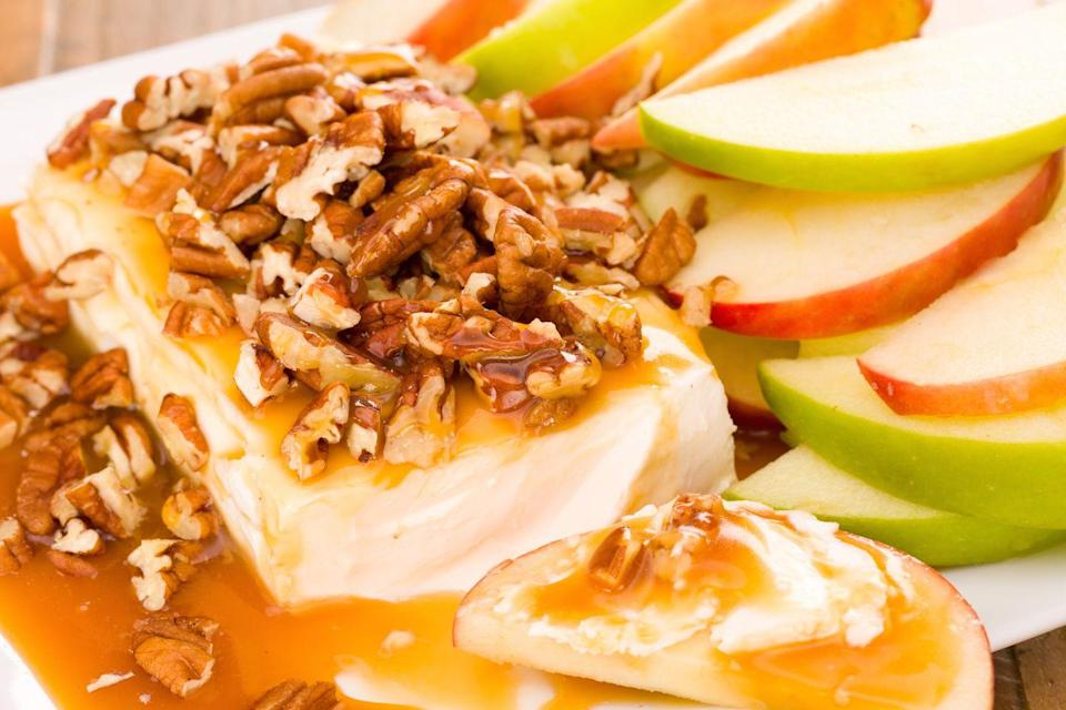 """<p>Here's how to dramatically dress up a block of cream cheese with caramel and pecans.</p><p>Get the recipe from <a href=""""https://www.delish.com/cooking/recipe-ideas/recipes/a43820/caramel-apple-cheesecake-dip-recipe/"""" rel=""""nofollow noopener"""" target=""""_blank"""" data-ylk=""""slk:Delish"""" class=""""link rapid-noclick-resp"""">Delish</a>.</p>"""
