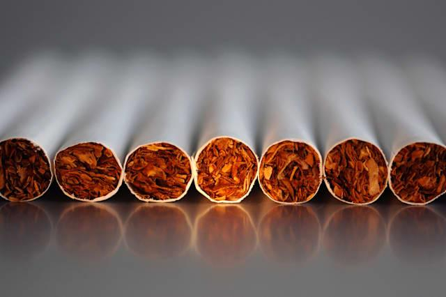 Close-up of few cigarettes on reflecting backgr.