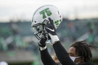 "A Marshall player points to a ""75"" decal after the team's win over Middle Tennessee during an NCAA college football game Saturday, Nov. 14, 2020, in Huntington, W.Va. (Sholten Singer/The Herald-Dispatch via AP)"