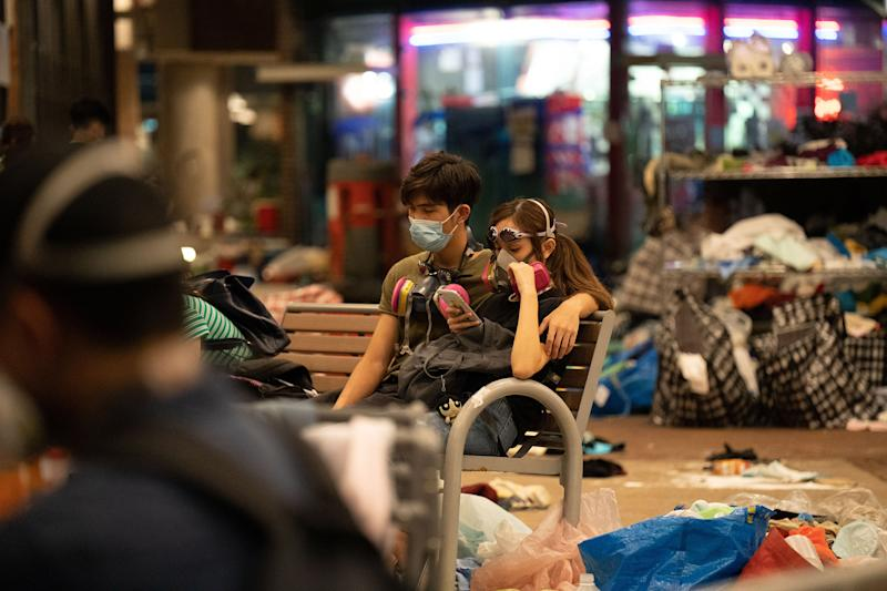 A couple waits for news of a rescue operation for protestors still trapped in PolyU, Nov. 18. | Bing Guan