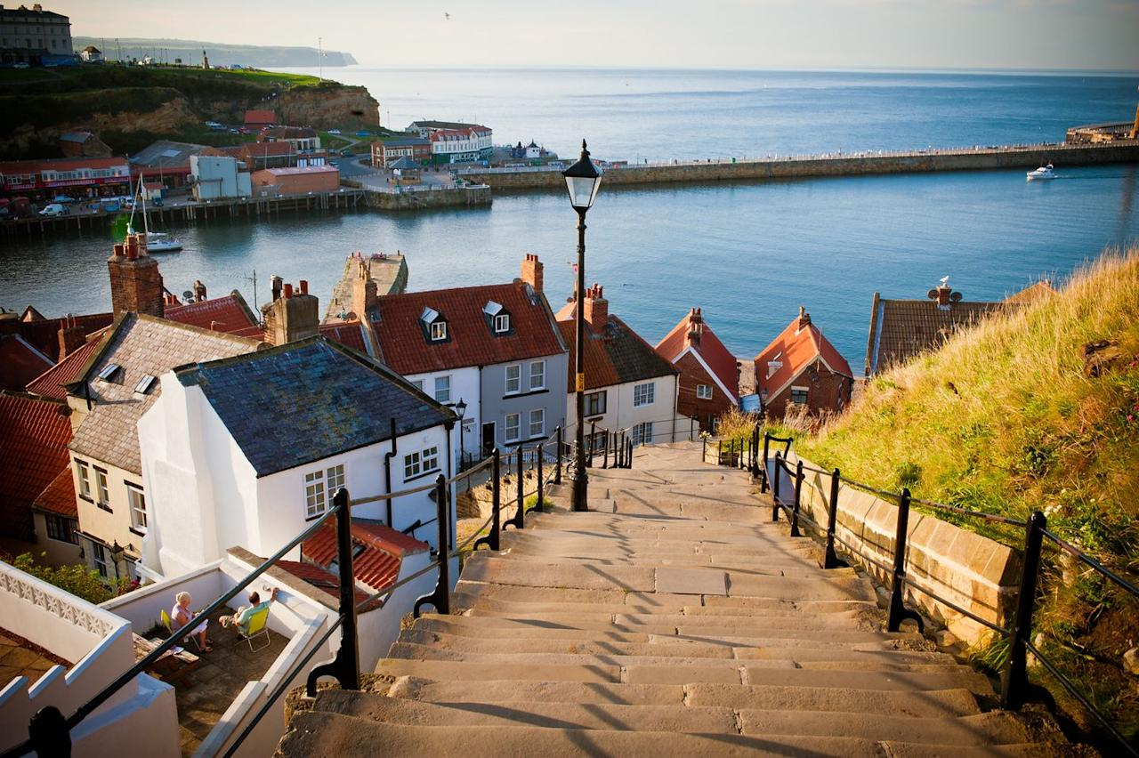 "<p>With 29 mountains and hills, the picture-perfect seaside town of Whitby has long been a favourite with holidaymakers in the UK. </p><p><strong>READ MORE</strong>: <a href=""https://www.countryliving.com/uk/travel-ideas/staycation-uk/a34040546/airship-scottish-highlands-airbnb/"" target=""_blank"">You can now rent this sustainable Airship in the Scottish Highlands via Airbnb</a></p>"