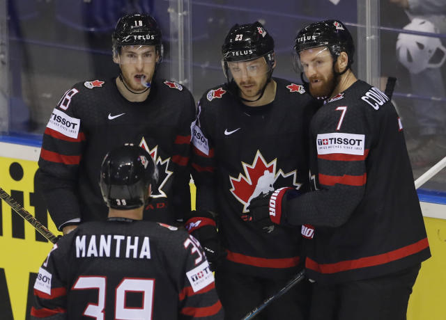 Canada's Sam Reinhart, 2nd right, celebrates with teammates after scoring his sides fourth goal during the Ice Hockey World Championships group A match between Canada and Denmark at the Steel Arena in Kosice, Slovakia, Monday, May 20, 2019. (AP Photo/Petr David Josek)