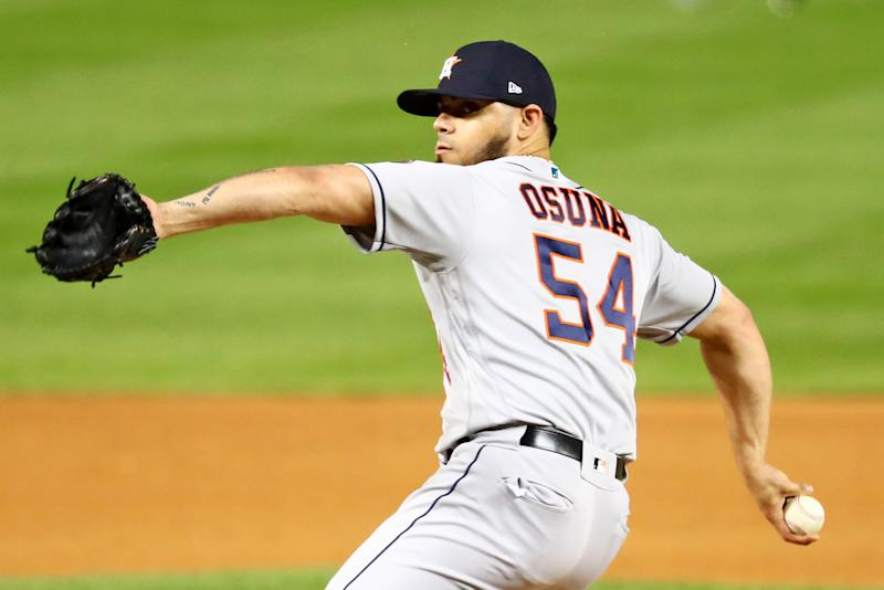 WASHINGTON, DC - OCTOBER 25: Roberto Osuna #54 of the Houston Astros pitches against the Washington Nationals during Game 3 of the 2019 World Series at Nationals Park on Friday, October 25, 2019 in Washington, District of Columbia. (Photo by Adam Glanzman/MLB Photos via Getty Images)