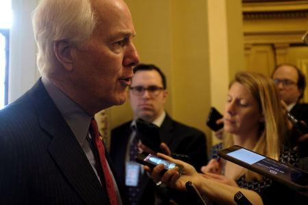 FILE PHOTO: U.S. Senate Majority Whip John Cornyn (R-TX) speaks with reporters after delivering remarks on the Senate floor about the involvement of the United States in Saudi Arabian hostilities inside Yemen, in Washington, U.S., March 19, 2018. REUTERS/James Lawler Duggan