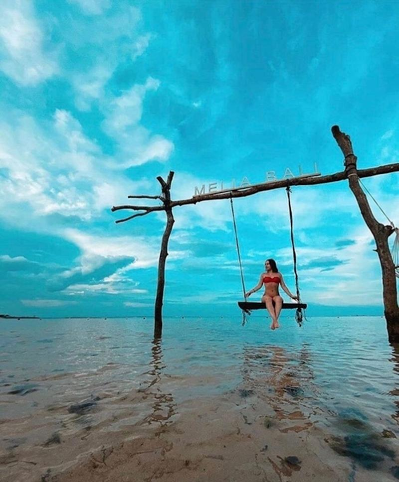 Avelina Nazarova, pictured on a swing, was said to be a strong swimmer but her strength proved no match for the current at Pasut Beach. Source: CEN/australscope